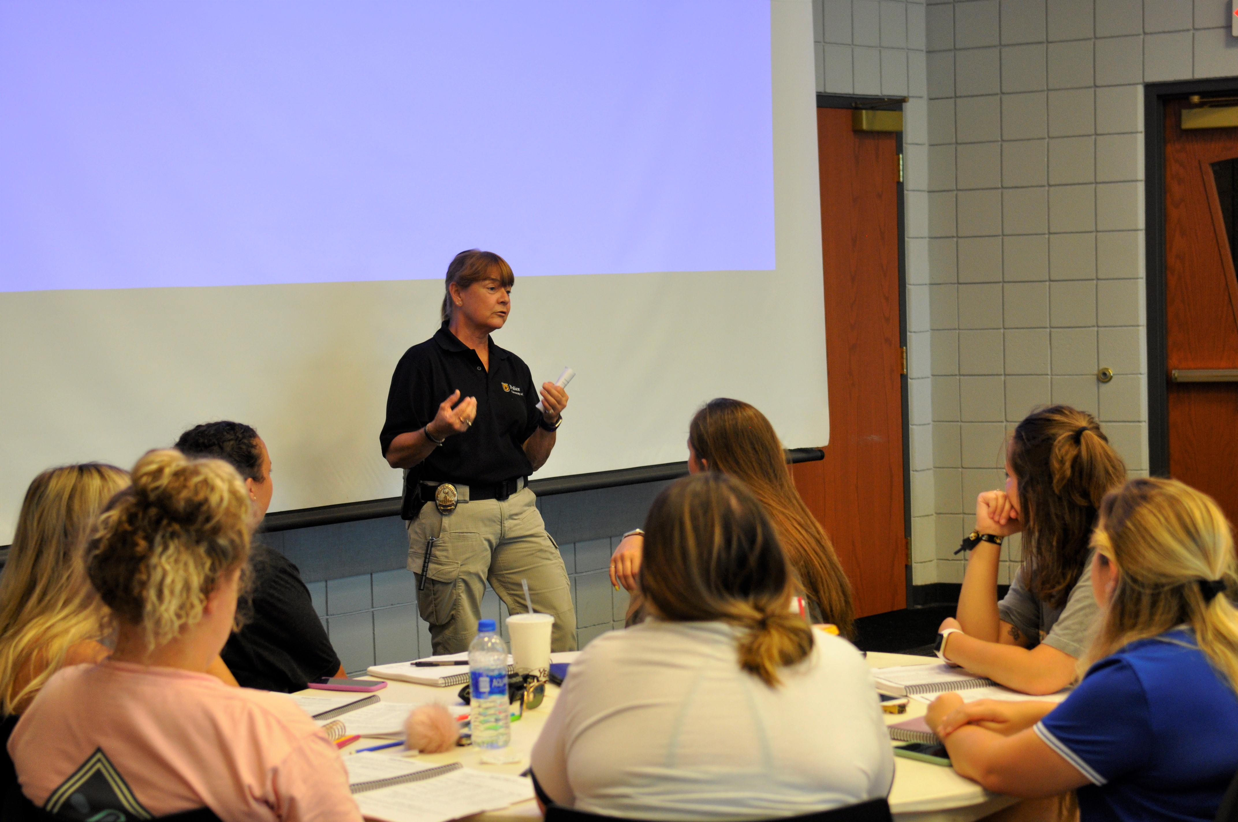 Joan Haaf, a crime prevention officer with the University of Missouri Police Department, met recently with members of several sororities associated with MU to talk about safety issue before upcoming rush week.